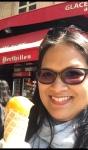smiling woman holding ice cream cone mango sorbet