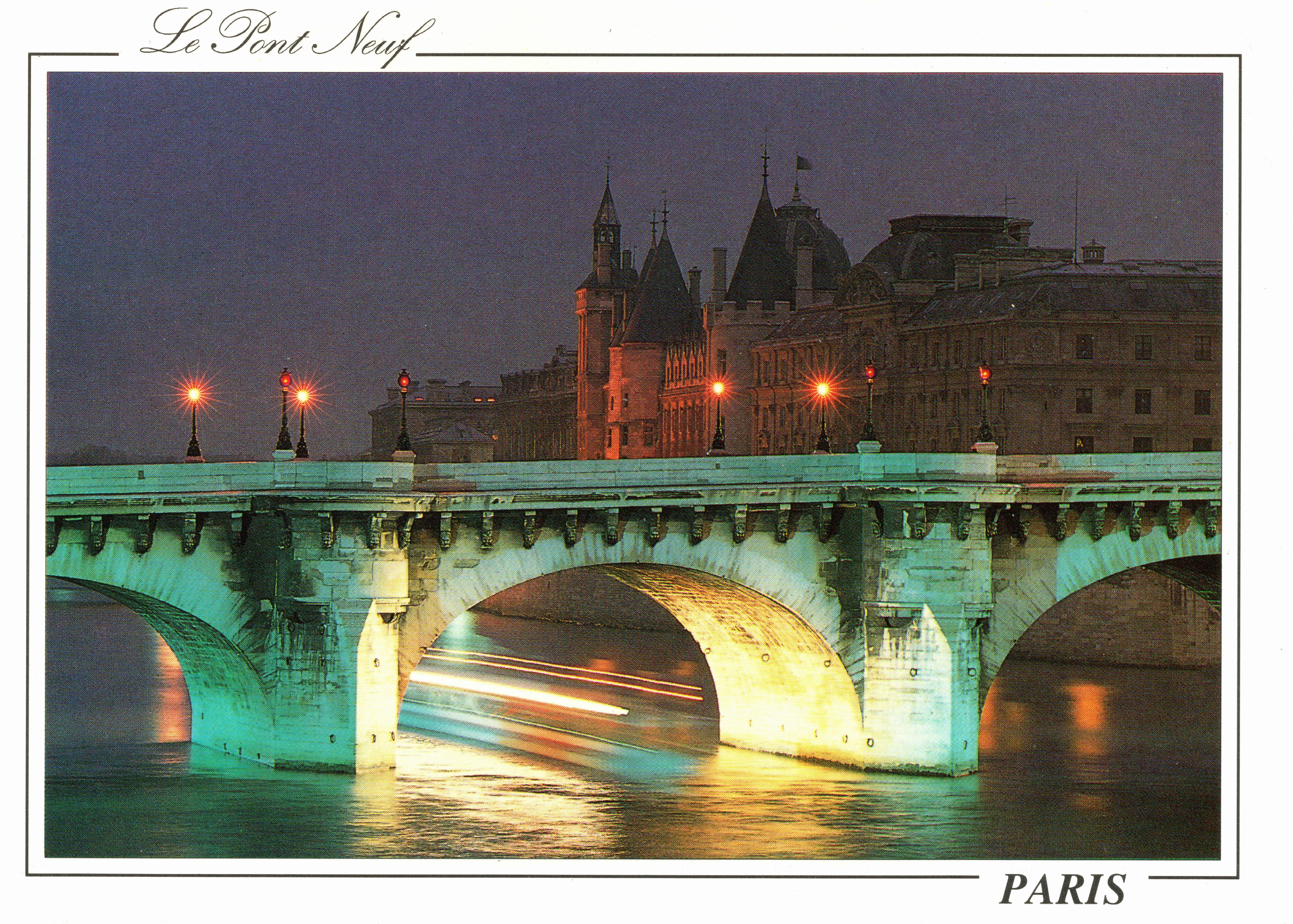 Paris at night Le Pont Neuf and La Conciergerie