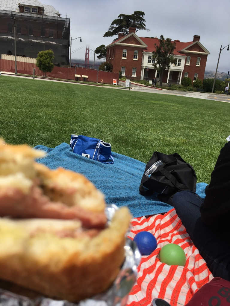 picnic blanket and bocce balls on grass